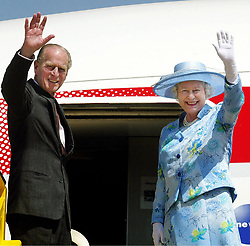 File photo dated 06/12/03 of the Duke of Edinburgh and Queen Elizabeth II waving goodbye as they board a plane at Abuja airport in Nigeria. The Duke of Edinburgh has died, Buckingham Palace has announced. Issue date: Friday April 9, 2020.. See PA story DEATH Philip. Photo credit should read: Kirsty Wigglesworth/PA Wire