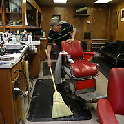 Greg Grime cleans up hair with Archbold Barber Shop in Archbold, Ohio, on Wednesday, July 25, 2018. THE BLADE/KURT STEISS