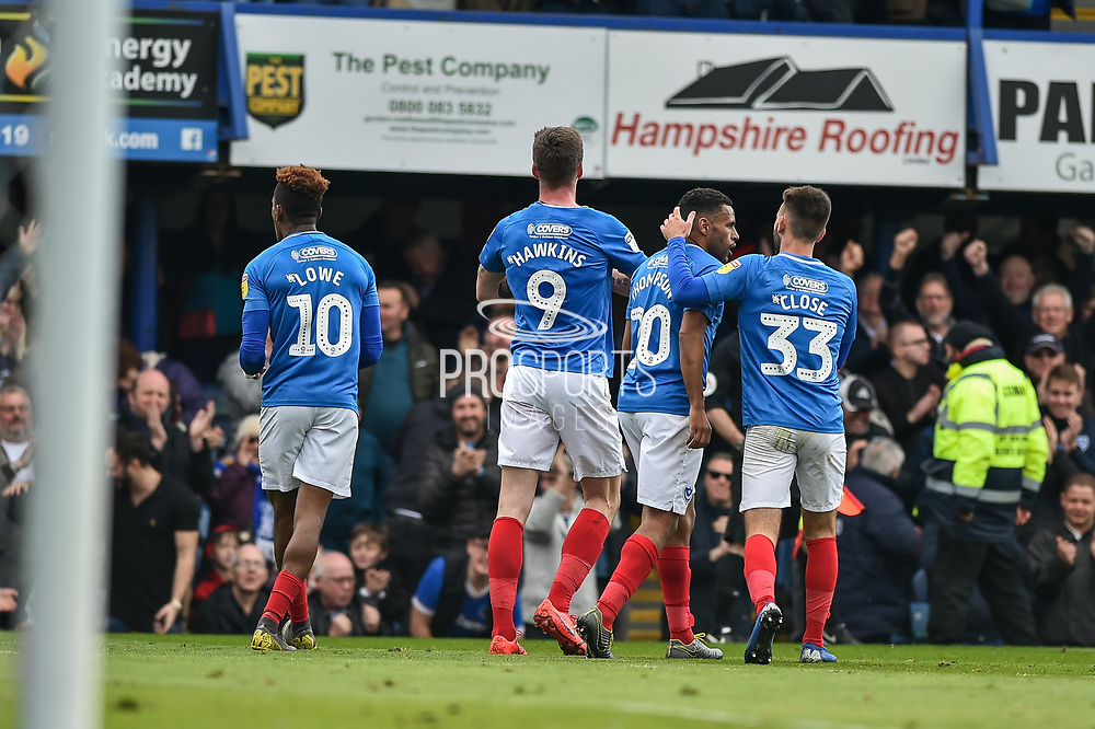 Portsmouth Players Celebrate after Portsmouth Forward, Oliver Hawkins (9) scores a goal to make it 1-0 during the EFL Sky Bet League 1 match between Portsmouth and Rochdale at Fratton Park, Portsmouth, England on 13 April 2019.