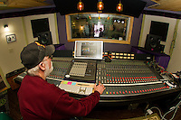 Franz Haase operates the control panel with Cameron McGonagle, Alan Loudon and Ryan Ordway in the recording studio for the Recording Coop in Gilford on Wednesday morning.  (Karen Bobotas/for the Laconia Daily Sun)