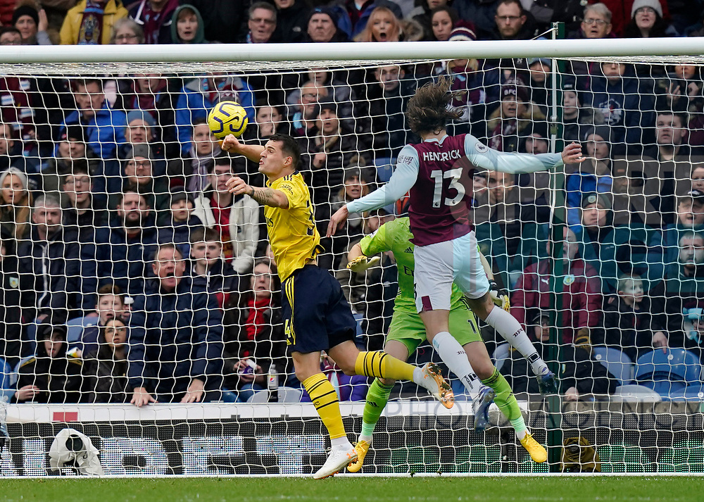 Jeff Hendrick of Burnley gets above Granit Xhaka of Arsenal but heads wide during the Premier League match at Turf Moor, Burnley. Picture date: 2nd February 2020. Picture credit should read: Andrew Yates/Sportimage