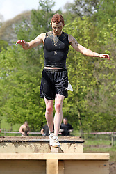 ©Licensed to London News Pictures. 13/05/2012.Boughton House, Northants. Tough Mudders go over the balance beam near the end of 12 mile endurance challenge..Photo credit: Steven Prouse/ LNP