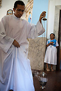 Congregation coming into Church / People workshipping in Church. Often the lines between Candomble and Catholicism are blurred. This is especially true with the Sao Lazaro event in late January in Salvador, Bahia, Brazil, the city which is known as the home of Candomble. Sao Lazaro represents healing and the sick.