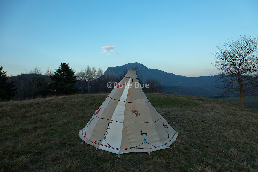 Teepee style tent with Pic de Bugarach in the background South France