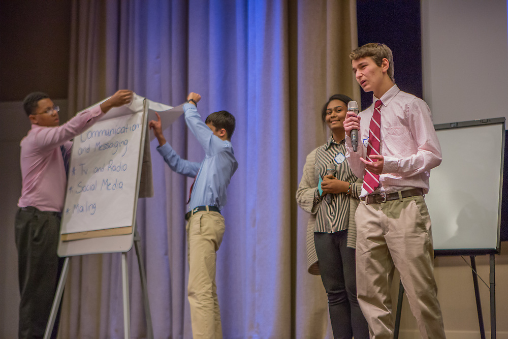 Purchase, NY – 31 October 2014. The team from White Plains High School presenting. (Left to right: Frank Marte,  Matthew Garrison, Alisa  Chaibay, Robert Lovitch.) White Plains High School went on to take first place in the 2014 competition. The Business Skills Olympics was founded by the African American Men of Westchester, is sponsored and facilitated by Morgan Stanley, and is open to high school teams in Westchester County.