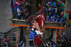 May 5, 2019 - Lalitpur, Nepal - Priests carry the idol of God of Rain ''Rato Machhindranath'' to place the deity inside the chariot in Lalitpur, Nepal on Sunday, May 5, 2019. Both Hindus and Buddhists worship Rato Machhindranath the God of Rain praying for good harvest. Devotees worship Machhendranath to prevent drought during the rice harvest season. A chariot of the deity placed inside is paraded around the ancient city and thousands of devotees from across the valley come to worship the God of Rain. (Credit Image: © Skanda Gautam/ZUMA Wire)