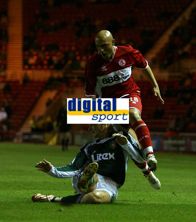 Photo: Andrew Unwin.<br /> Middlesbrough v Liteks Lovech. UEFA Cup. 15/12/2005.<br /> Middlesbrough's Massimo Maccarone (R) hurdles a challenge from Liteks Lovech's Jean-Philippe Caillet (L).