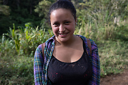"""Noelia Sagastume came walking from Peña Blanca to San Luis Planes, 2.5 hours walk, after the road to San Luis Planes was ruined by the hurricanes Eta and Iota. """"We've all been affected by the hurricanes, not just because of the roads, but all local work is affected, people have lost their farms, there's no coffee picking, and people who rely on farm labouring are suffering""""."""