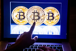 A view of Bitcoin coins on a computer screen on December 12, 2017. Virtual currency bitcoin hit another all-time peak on Tuesday, two days after the launch of the first ever bitcoin futures on a U.S. exchange and ahead of the start of another futures contract next week, as investors grew optimistic that the Dollars 20,000-mark is within reach. Photo by Robin Utrecht/ABACAPRESS.COM