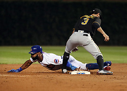 August 28, 2017 - Chicago, IL, USA - Chicago Cubs right fielder Jason Heyward (22) steals second base in front of Pittsburgh Pirates first baseman Sean Rodriguez (3) during the second inning of their game Monday, Aug. 28, 2017 at Wrigley Field in Chicago. (Credit Image: © Nuccio Dinuzzo/TNS via ZUMA Wire)