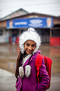 Portrait of 12 years old Roma girl Georgiana on her way home from school where she is attending classes together with Roma and non Roma children located in the city of Marginenii de Jos.