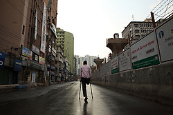 April 2, 2020, Dhaka, Bangladesh: After little raining, a disabled man walks by crutches through the empty road in Motijheel commercial area, Dhaka, Bangladesh on 02 April 2020, during the nationwide lockdown as a preventive measure against the COVID-19 coronavirus pandemic. (Credit Image: © Apollo Shafayet Hossain/ZUMA Wire/ZUMAPRESS.com)