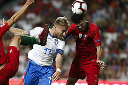 September 10, 2018 - Lisbon, Portugal - Ciro Immobile of Italy and SS Lazio (L) heads for the ball with Pepe of Portugal and Besiktas (R)  during the UEFA Nations League A group football match between Portugal and Italy, in Lisbon, on September 10, 2018. (Credit Image: © Carlos Palma/NurPhoto/ZUMA Press)