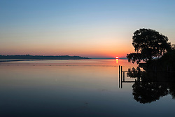 Sun shining over Chiemsee lake, Bavaria, Germany