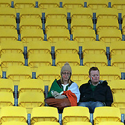 Two Irish fans contemplate their sides defeat after the Ireland V Wales Quarter Final match at the IRB Rugby World Cup tournament. Wellington Regional Stadium, Wellington, New Zealand, 8th October 2011. Photo Tim Clayton...