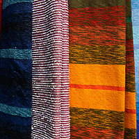 Africa, Morocco, Fes. Woven Moroccan silk textiles and scarves.