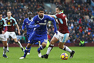 Diego Costa of Chelsea looks to get away from Joey Barton of Burnley. Premier league match, Burnley v Chelsea at Turf Moor in Burnley, Lancs on Sunday 12th February 2017.<br /> pic by Chris Stading, Andrew Orchard Sports Photography.