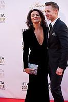 Deirdre O'Kane, host of the awards ceremony and John Edward Nolan  at the IFTA Film & Drama Awards (The Irish Film & Television Academy) at the Mansion House in Dublin, Ireland, Thursday 15th February 2018. Photographer: Doreen Kennedy