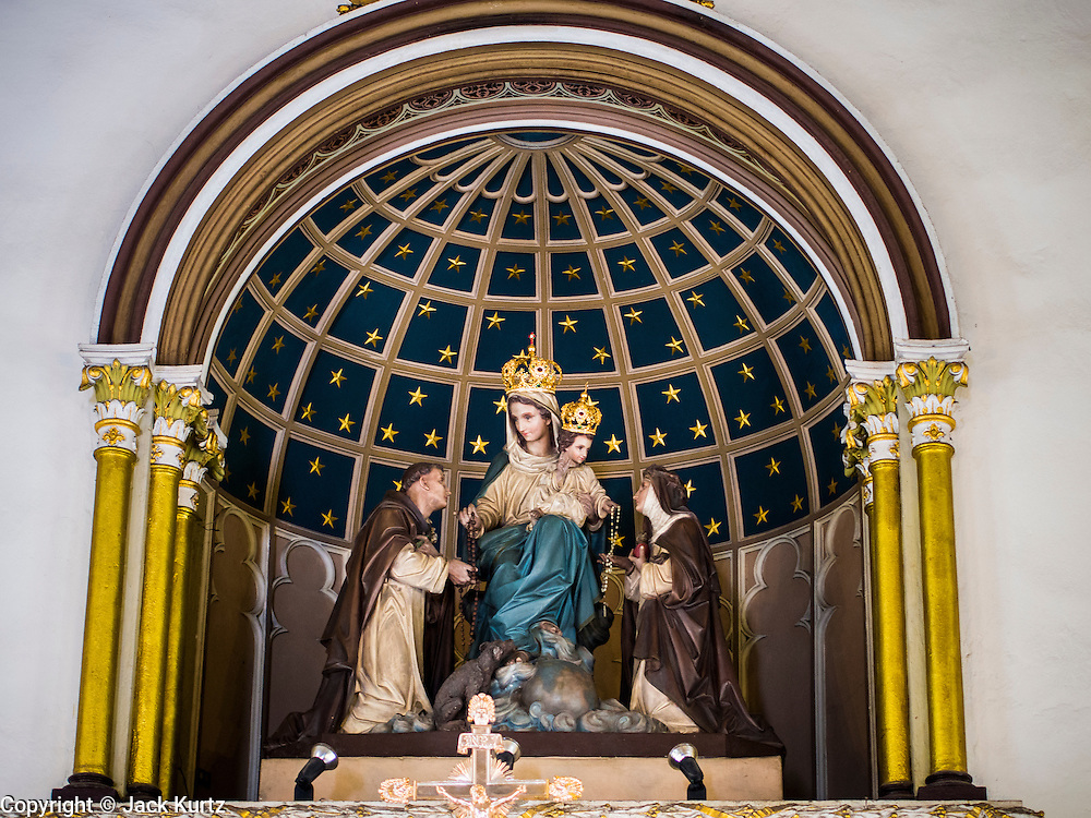 14 AUGUST 2014 - BANGKOK, THAILAND: A statue of Mary and Baby Jesus in the sanctuary of Holy Rosary Church in the Talat Noi section of Bangkok. Holy Rosary Church, Wat Mae Phra Luk Prakham, is also known as Kalawar Church. The church was built with a land grant from King Rama I in 1786, about four years after Bangkok was established as Siam's capital. Many Catholic Vietnamese and Cambodians fled to Bangkok during the wars in Indochina and adopted this church as their main house of worship. It has been rebuilt twice. The present church was built in the late 1890s. The cream-colored church has a towering spire and European style stained-glass windows.    PHOTO BY JACK KURTZ