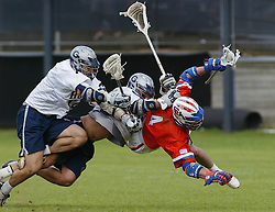 03 May 2003:  Mike Hammer (center) takes out a player during a lacrosse match between the Georgetown Hoyas and the Syracuse Orange.