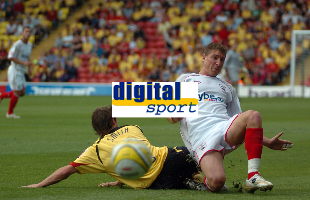 Photo: Tony Oudot.<br /> Watford v Southampton. Coca Cola Championship. 16/09/2007.<br /> Gregory Vignal of Southampton clears from Tommy Smith of Watford