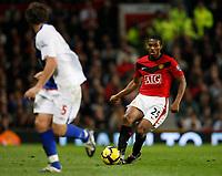 Photo: Steve Bond/Richard Lane Photography. Manchester United v Blackburn Rovers. Barclays Premiership 2009/10. 31/10/2009. Antonio Valencia (R) has Gael Givet backpeddling