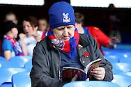 a Crystal Palace fan reading the match day programme before k/o. Premier League match, Crystal Palace v Stoke city at Selhurst Park in London on Sunday 18th Sept 2016. pic by John Patrick Fletcher, Andrew Orchard sports photography.
