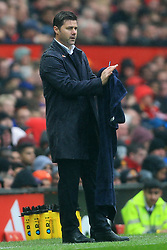 28th October 2017 - Premier League - Manchester United v Tottenham Hotspur - Spurs manager Mauricio Pochettino dries his coat with a towel - Photo: Simon Stacpoole / Offside.