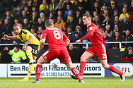 Burton Albion midfielder Marcus Harness (16) shoots at goal during the EFL Sky Bet League 1 match between Burton Albion and Accrington Stanley at the Pirelli Stadium, Burton upon Trent, England on 23 March 2019.