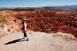 USA, Utah, woman hiking in morning light at Sunrise Point in Bryce Canyon National Park.