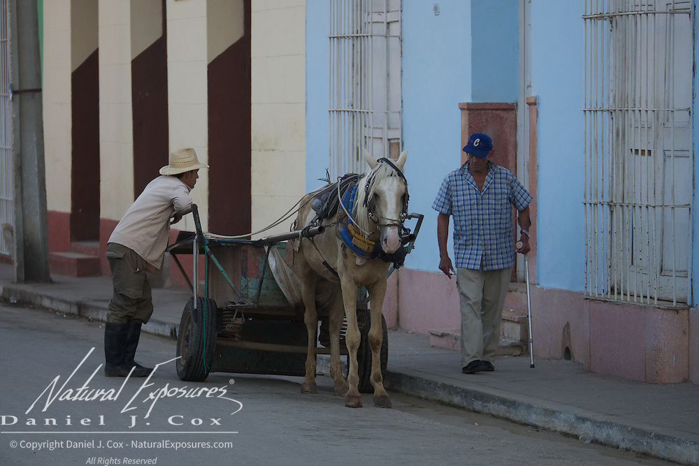 Unloading a horse drawn wagon in Trinidad, Cuba.