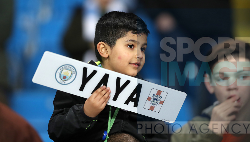 Young Fan with a car number plate bearing the name of Yaya Toure of Manchester City before the English Premier League match at The Etihad Stadium, Manchester. Picture date: December 12th, 2016. Photo credit should read: Lynne Cameron/Sportimage