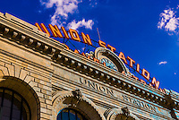 """The old Union Station """"Travel by Train"""" neon sign above the newly renovated Denver Union train station, Downtown Denver, Colorado USA."""