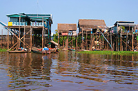 Kampong Khleang Stilt Houses - The Tonle Sap is a combined lake and river system of huge importance to Cambodia. The Tonle Sap is the largest freshwater lake in Southeast Asia and is an ecological hot spot that was designated as a UNESCO biosphere in 1997. For most of the year the lake is small, only one meter deep with an area of 2700 square kilometers. During the monsoon season, the Tonle Sap river reverses its flow increasing its area to 16000 square km and its depth to up to nine meters, flooding nearby fields and forests.  This flooding, however, provides a perfect breeding ground for fish.