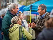 19 OCTOBER 2019 - DES MOINES, IOWA: MARK SANFORD (R-SC), right, talks to visitors to the Des Moines Farmers' Market during a campaign visit to the market Saturday. Sanford, a former Republican governor and Congressman from South Carolina, is challenging incumbent President Donald Trump for the Republican nomination for the US presidency. Iowa hosts the first event of the presidential selection cycle. The Iowa Caucuses are scheduled for February 3, 2020.              PHOTO BY JACK KURTZ
