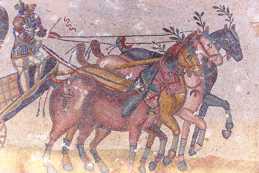 Detail of horses drawing a chariot at the Circus Maximus. Roman mosaics at the Villa Romana del Casale which containis the richest, largest and most complex collection of Roman mosaics in the world. Constructed  in the first quarter of the 4th century AD. Sicily, Italy. A UNESCO World Heritage Site. .<br /> <br /> If you prefer to buy from our ALAMY PHOTO LIBRARY  Collection visit : https://www.alamy.com/portfolio/paul-williams-funkystock/villaromanadelcasale.html<br /> Visit our ROMAN MOSAIC PHOTO COLLECTIONS for more photos to buy as buy as wall art prints https://funkystock.photoshelter.com/gallery/Roman-Mosaics-Roman-Mosaic-Pictures-Photos-and-Images-Fotos/G00008dLtP71H_yc/C0000q_tZnliJD08