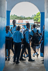 4 November 2019, Montserrado, Liberia: Students pass through the corridor during recess. Started as a school for internally displaced children during the First Liberian Civil War, Mother Tegeste Stewart Apostolic Pentecostal Mission School in Montserrado county currently teaches 486 students from kindergarten up through 12th grade.