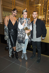 Left to right X Factor contestant SEANN MILEY MOORE, stylist GEMMA SHEPPARD and X Factor contestant MASON NOISE at a party to celebrate the launch of the Balmain H&M collection held at H&M Regent Street, London on 4th November 2015.