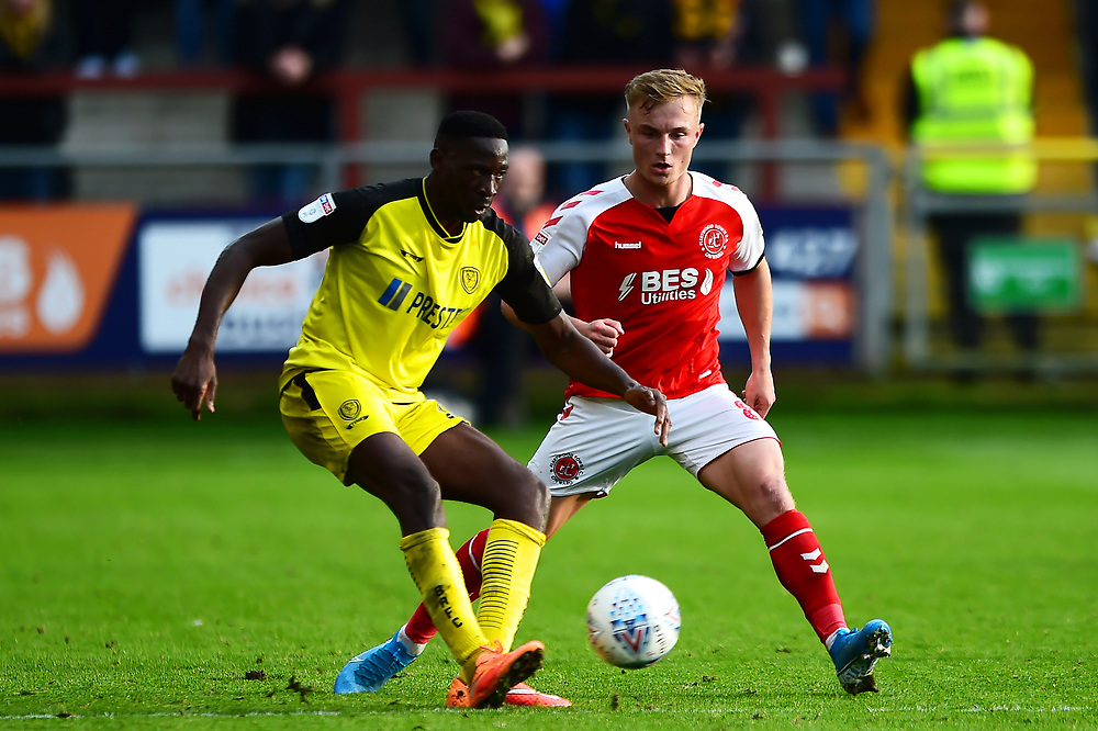 Fleetwood Town's Kyle Dempsey competes with Burton Albion's Lucas Akins<br /> <br /> Photographer Richard Martin-Roberts/CameraSport<br /> <br /> The EFL Sky Bet League One - Fleetwood Town v Burton Albion - Saturday 19th October 2019 - Highbury Stadium - Fleetwood<br /> <br /> World Copyright © 2019 CameraSport. All rights reserved. 43 Linden Ave. Countesthorpe. Leicester. England. LE8 5PG - Tel: +44 (0) 116 277 4147 - admin@camerasport.com - www.camerasport.com