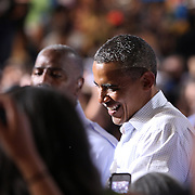 President Barack Obama shakes hands with supporters after finishing his Grassroots event at the Kissimmee Civic Center in Kissimmee, Florida on Saturday, September 8, 2012. (AP Photo/Alex Menendez)