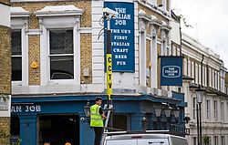 © Licensed to London News Pictures. 24/08/2018. London, UK. CCTV and a sound system being installed on the streets of Notting Hill, West London ahead of the 2018 Notting Hill Carnival which starts this weekend. Photo credit: Ben Cawthra/LNP