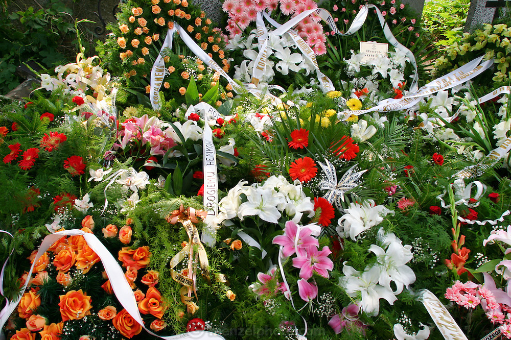 Funeral of Henryk Nowicki in Powazek Cemetery, Warsaw Poland. Flowers on fresh grave after burial.