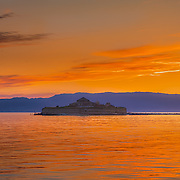 www.aziznasutiphotography.com                                         Picture has been taken from Pirbadet towards the Munkholmen islet in Trondhein in a July late sunset.
