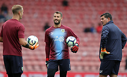 """Burnley goalkeepers Joe Hart (left) and Adam Legzdins with goalkeeping coach Billy Mercer before the Premier League match at St Mary's, Southampton. PRESS ASSOCIATION Photo. Picture date: Sunday August 12, 2018. See PA story SOCCER Southampton. Photo credit should read: Andrew Matthews/PA Wire. RESTRICTIONS: EDITORIAL USE ONLY No use with unauthorised audio, video, data, fixture lists, club/league logos or """"live"""" services. Online in-match use limited to 120 images, no video emulation. No use in betting, games or single club/league/player publications."""