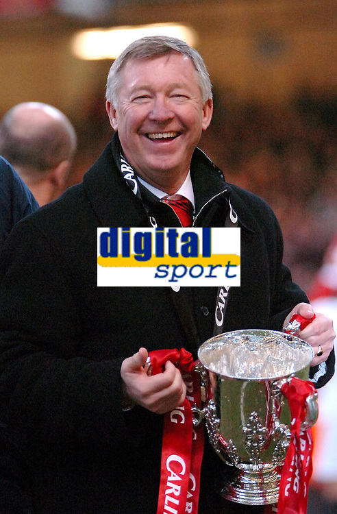 Photo: Ed Godden.<br />Manchester United v Wigan Athletic. The Carling Cup Final. 26/02/2006. Man Utd manager, Alex Ferguson, celebrates his teams win.