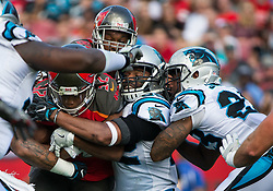 January 1, 2017 - Tampa, Florida, U.S. - Tampa Bay Buccaneers running back JACQUIZZ RODGERS (32) runs the ball into Carolina Panthers defense traffic during the first half of NFL action at Raymond James Stadium. (Credit Image: © Loren Elliott/Tampa Bay Times via ZUMA Wire)