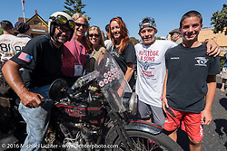 `This is the end my friend, 3,400 miles from the Atlantic to the Pacific. The journey is over. Anthony Rutledge of Connecticut on his 1915 Harley-Davidson class-3 motorcycle surrounged by his family and friends at the finish line of the Motorcycle Cannonball Race of the Century. Stage-15 ride from Palm Desert, CA to Carlsbad, CA. USA. Sunday September 25, 2016. Photography ©2016 Michael Lichter.