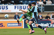 Lyle Taylor of AFC Wimbledon (l) takes a shot at goal. Skybet football league two match, Wycombe Wanderers  v AFC Wimbledon at Adams Park  in High Wycombe, Buckinghamshire on Saturday 2nd April 2016.<br /> pic by John Patrick Fletcher, Andrew Orchard sports photography.