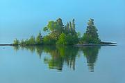 Caron Island reflection on Lake Superior<br />Rossport<br />Ontario<br />Canada