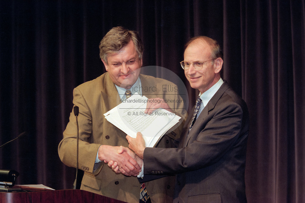 Edgar Bronfman, Sr with US Under Secretary of State Stuart Eizenstat at the opening ceremony for the Conference on Holocaust-Era Assets at the US Holocaust Museum November 30, 1998 in Washington, DC.